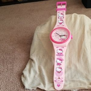 Gently used Hello Kitty watch wall clock
